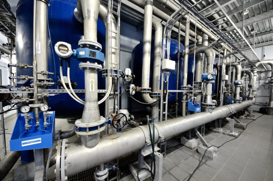 Coal-burning power plant boiler using custom pressure vessel components